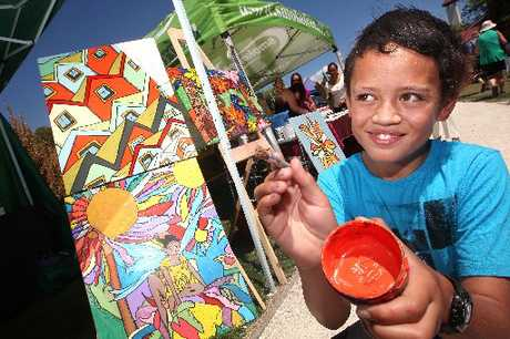 ENJOYING ART: Jaz Te Pairi, 11, gets involved with some art at Rotorua&#39;s Art in the Park event at the weekend.