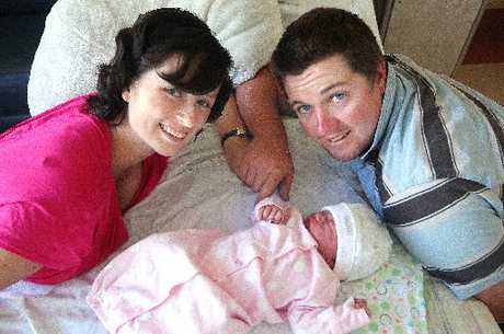 QUICK DELIVERY: Chris Roberton and his wife Ashleigh with their baby, Heidi Maree Roberton, who was delivered in a car on the side of a road by Chris, a volunteer ambulance officer.