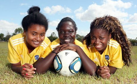 Logan Metro football club is helping players from disadvantaged countries. Pictured is Ariane Uwimana, Grace Edward and Martiae Mpungu. Photo: Inga Williams / The Reporter