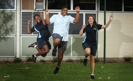 Adoree Kalisa, Shelvin Sen and Caitlin Moran are jumping for joy that Mabel Park State High School's graduating year 12 students from 2012 received outstanding results. Photo: Inga Williams / The Reporter