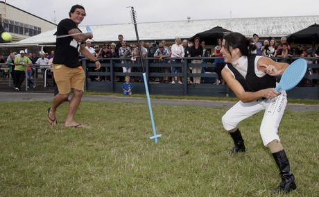 ON TRACK: Jockey Sam Spratt (left), Zac Guildford's girlfriend of eight months, said Guildford was responding well to alcohol counselling. The two are pictured here playing Swingball at the Whangarei Racing Club's Summer Festival meeting in January this year.