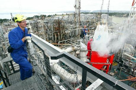 REFUELLING: A Marsden Pt oil refinery engineer oversees replacement catalyst being poured into the hydrocracker during an earlier shutdown.