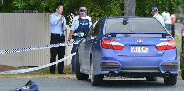 Police and detectives at the scene of a homicide investigation on Boddington Street.