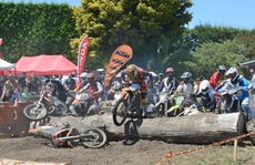 MAD SCRAMBLE: The KTM of Chris Hilton completes the first obstacle but leaves its rider behind as the field gets away at the start of the Last Chance race.