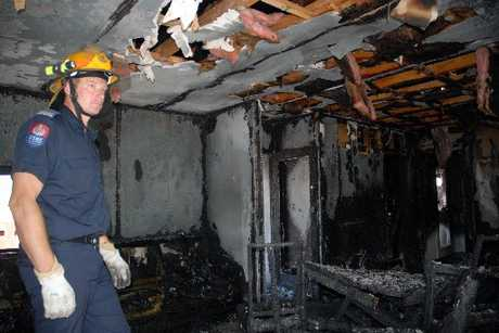 GUTTED: Masterton firefighter Murray Pike surveys the devastation of a blaze that erupted in a Masterton home while the occupants, a mother and her three children, slept yesterday morning.