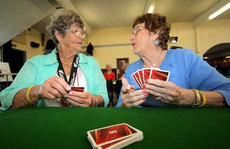 HERE'S LOOKING AT EUCHRED: Val Travers (left) and Anne McGinity play euchre at the Castlecliff Club during the Masters Games.