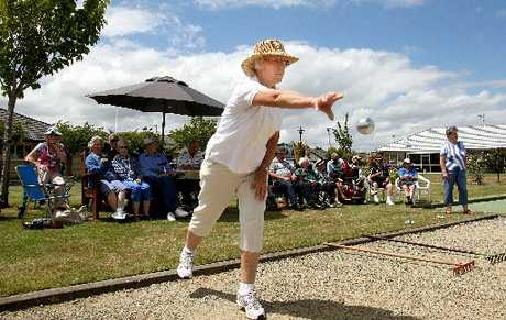 ACTION SHOT: Summerset resident Adriana Van Den Broek competes in petanque in the village square yesterday.