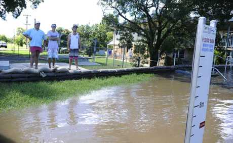 Angus McDonald, Nick Crispin and Alex Cole at the Fry St levee during the last flood event. Photo: JoJo Newby / The Daily Examiner