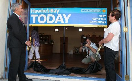 Napier mayor Barbara Arnott and Hastings District mayor Lawrence Yule unveil the new Hawke&squot;s Bay Today masthead last night. Picture Duncan Brown.