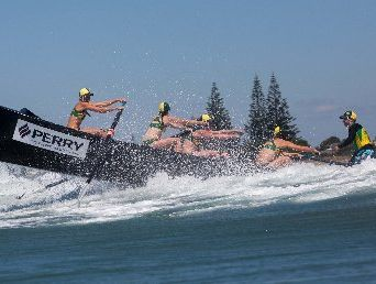 BIG SURF: The North Cottesloe women&#39;s crew head out through the Waihi Beach waves.