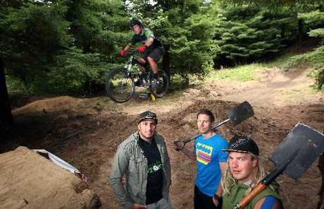 Trail builders Tak Mutu, Chris Martin, Jordie Dorfliger and Joe Styles (on bike) at Rotorua's newest mountain bike track on the slopes of Mt Ngongotaha.