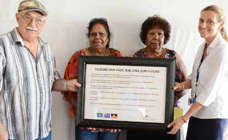 Brett Green, Aunty Sandra Malone, Aunty Lillian Burke and Heather Kelly at Gympie State High School yesterday, with a framed signed extract of Kevin Rudd&#39;s apology to aboriginal and islander Australians.