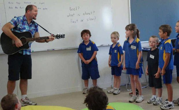 LEARNING SONGWRITING ART: Last year's X Factor top 10 contestant Justin Standley with Valkyrie State School students Rebecca Armstrong, Cooper Hutton, Sophie Clein, Riley Armstrong, Corey Deguara, Tom Collins, Ellie Collins, Ally Green and Breanna Lloyd.