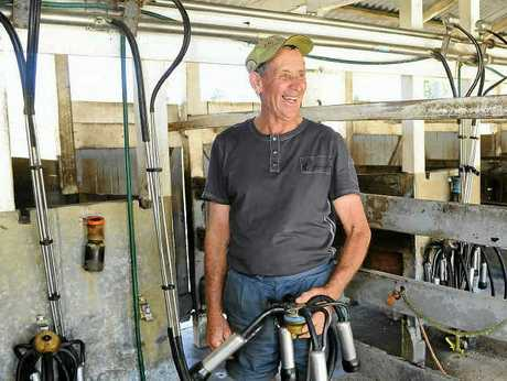MOOOVING ON: Bob O'Grady in the milking stalls. After generations of farming, Bob has retired from dairy farming. The Australian Bureau of Agricultural and Resource Economics and Sciences will explore world food security at its annual conference next month.