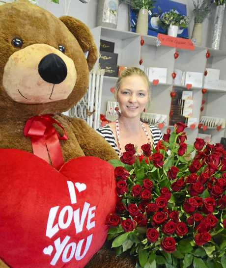 SURROUNDED BY LOVE: Carmen Maguire has her hands full this Valentine's Day at Emerald's Blissful Blooms Florist.