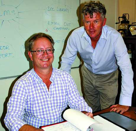 EXPANSION PLANS: John Magrath, left, and Elders Palmwoods principal Mike Burns discuss the commercial property division of the agency. Photo: Erle Levey