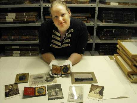 MY PRECIOUS: Whanganui Regional Museum archivist Sandy Black with some of the old photographs and daguerreotypes held in the museum's archives. The museum is one of the places that will receive a visit from members of an international photographic conservators' conference at the weekend. PHOTO/ANNE-MARIE EMERSON