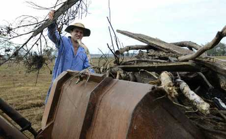 Armidale university student Tom Granleese clears flood debris from Clarendon Farm near Ulmarra.