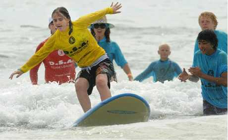 Sarah Hure of Grafton has a great time with the Disabled Surfers Association Far North Coast Surfers at Minnie Water.