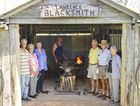 Blacksmith Eoin McSwan (centre) with Lawrence Museum organisers (from left) Nev Rosendale, Esther Smith, Rae Harrison, Warren Hulme, Terry Harrison and Vois Bancroft in the new blacksmith's shed. Photo: Adam Hourigan