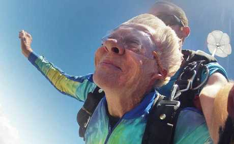 Free from the roar of the wind, Audrey Gwillim enjoys the peaceful part of skydiving as she floats to earth.