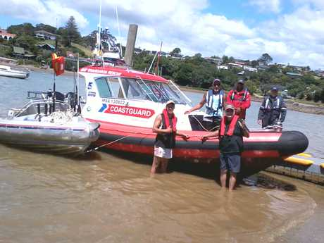 WELCOME HOME: Mike Ward (standing in the water, right) and his son John with Whangaroa Coastguard crew moments after landing at Mill Bay after a fishing trip neither will forget.