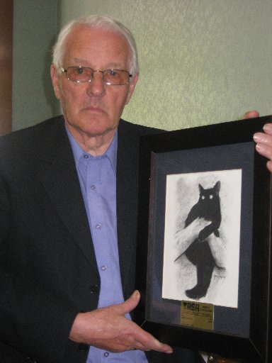 FREQUENT VISITOR: The Watts Davies' painting of Boss Cat, a long-time fixture at the North Otago RSA in Oamaru. PHOTO/JACQUIE WEBBY
