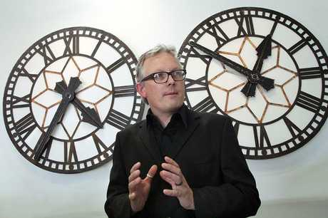 FROZEN: Exhibition manager Stephen Pennruscoe in front of the two clock faces taken from the former Railway Station in Moorhouse Ave, one of which stopped at 4.35am on September 4, 2010 and the other is frozen at 12.51pm on February 22, 2011.