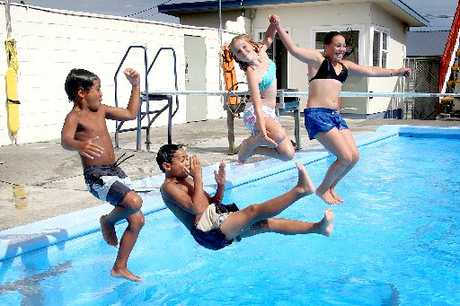 TAKING THE PLUNGE: From left, Raymond Rapana-Tuirirangi, 9, Mathew Rapana-Tuirirangi, 10, Rosa Blom, 12, and Sophie Brown, 12, enjoy free entry to Wanganui East Pool yesterday afternoon.