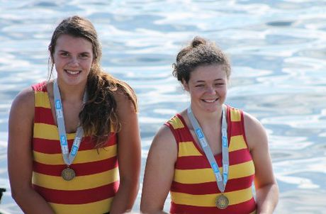 GOLDEN GIRLS: Aramaho Wanganui Rowers Sammy Murphy (left) and Georgia Nugent-O'Leary with their North Island women's novice double sculls medals at Lake Karapiro last week.