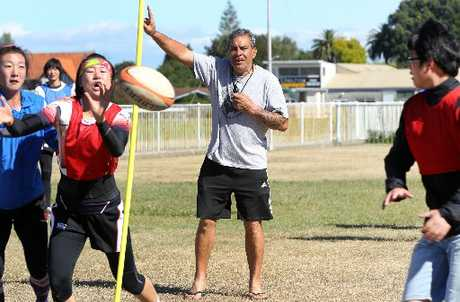 Adam McDonald puts members of the Jiangsu Sports Bureau Training Centre's women's sevens team through some drills in the buildup to tomorrow's Hawke's Bay Sevens at Waipukurau.
