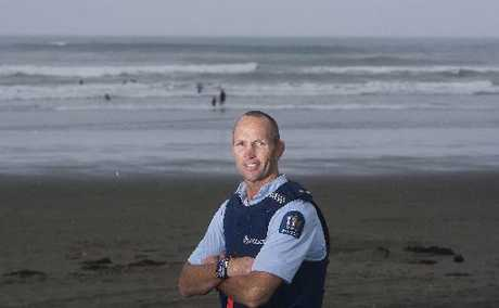 Whakatane police officer Constable Dean Oswald at Ohope, where he rescued three swimmers in trouble.