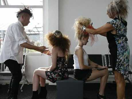 Hairdresser Joel Hornell (left) adds finishing touches to model Fran Skullan&#39;s hair while Andrea McKay makes sure Zoe Stonex&#39;s hair stays where it should. 