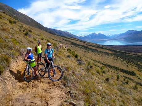 WAIT OVER: These keen riders had a peek at the almost-linked trail from Lake Ohau to Omarama recently. By tomorrow it will be completed and ready to ride. PHOTO/HAMISH SEATON