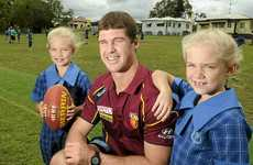 LIONHEARTED LEADERS: Twins Brittney (left) and Brooklyn Karrasch with Lions Captain Jonathan Brown.