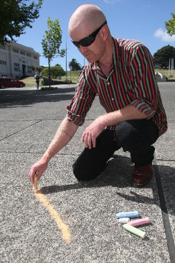 PAVEMENT ART: Pat Cush gets in some practise ahead of Saturday, when he'll draw a giant snake for people to colour-in during Chinese New Year celebrations.PHOTO/BEVAN CONLEY