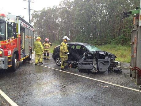 TWO people were trapped after a two car crash on Yandina-Coolum Rd.