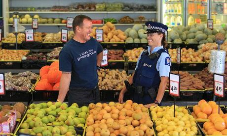 Community Constable Leanne Fairbairn talks to The Fresh Market's David Stewart whilst on foot patrol at Gate Pa Shopping Centre.