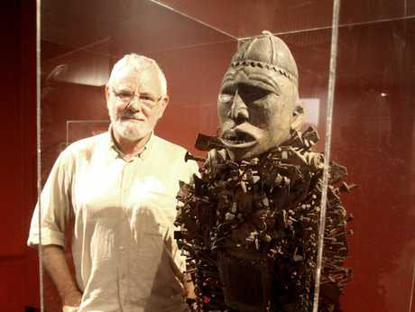 WORLDS APART: Des Bovey, with a nkisi from the mouth of the Congo River. It is one of 100 pieces in his Minkisi exhibition at the Whanganui Regional Museum until August. The totems act as a go between for people and spirits.PHOTO/BEVAN CONLEY 070213WCBRCMO04