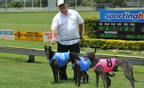 Murwillumbah trainer Jimmy Madigan with his three winners at Casino on Friday. Photo Lisa Vanderstok
