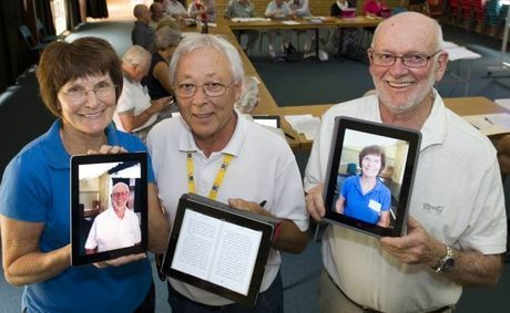 Learning the many uses of an iPad are Lina Pervan and Jim Horsburgh with U3A&squot;s iPad tutor Tom Fusae.