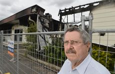 Former Millmerran Sports Club president Roy Flynn visits the scene of destruction.