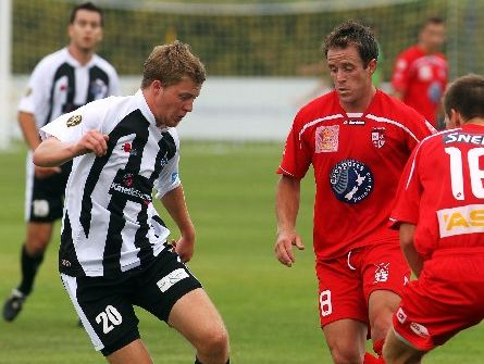 Hawke&#39;s Bay United midfielder Conor Tinnion (with ball) feels the heat as Waitakere United&#39;s Chad Coombes and a teammate crowd him during the ASB Premiership soccer match at Park Island, Napier, yesterday. 