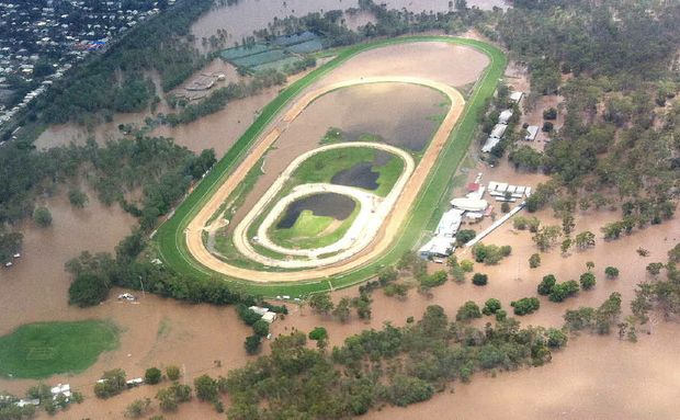 ROCKY REELS: An aerial view of the swollen Fitzroy River in flood-hit Rockhampton.