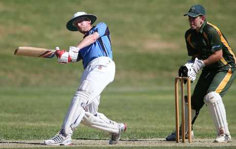 Tai Bridgeman of Te Puke swings a ball away in front of Mount wicketkeeper Hayden Burns during a Baywide Twenty20 cricket match at Blake Park.