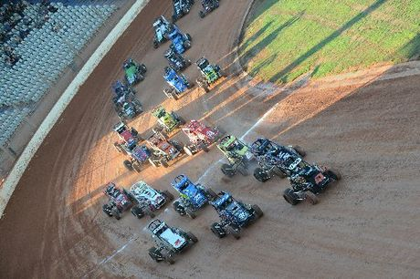 Rose Halfpenny (47) leads the big field to the green flag for the opening midget car race at Baypark Speedway on Saturday night.