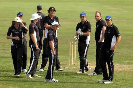 Central Hawke's Bay players wait for the arrival of another Taradale batsman after a a clean-bowled wicket at Nelson Park, Napier, yesterday.