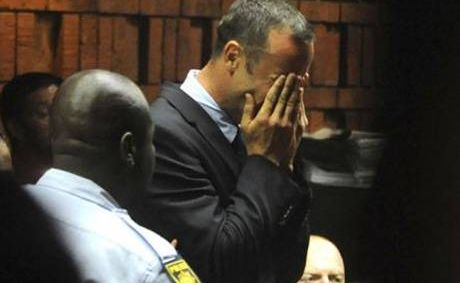 Athlete Oscar Pistorius weeps in court in Pretoria at his bail hearing in the murder case of his girlfriend Reeva Steenkamp.