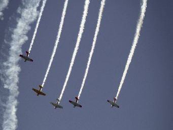 The Harvard Warbirds in the skies over the Napier waterfront during a series of displays for Art Deco crowds thronging Marine Parade in their thousands.