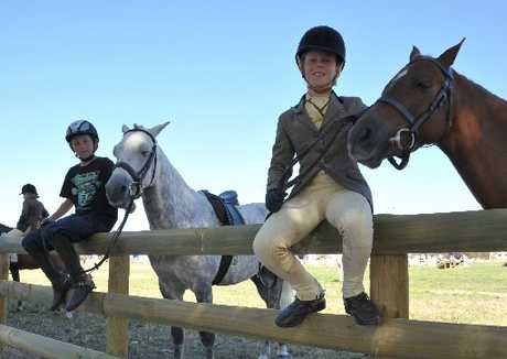 READY AND WAITING: Hunter Durrant riding Ash and Ally Stevenson riding Dulce wait their turn in the Working Hunter event.